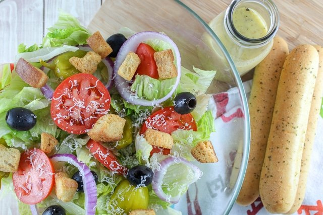 Who doesn't have a deep-seeded love for Olive Garden? And if you love the OG - then you HAVE to love their house salad and Italian dressing! This recipe is perfection! I tested it side-by-side with the real deal and you will love it! What's in the Olive Garden House Salad? Keep reading and you'll know! #olivegarden #copycat #olivegardensalad #italiandressing