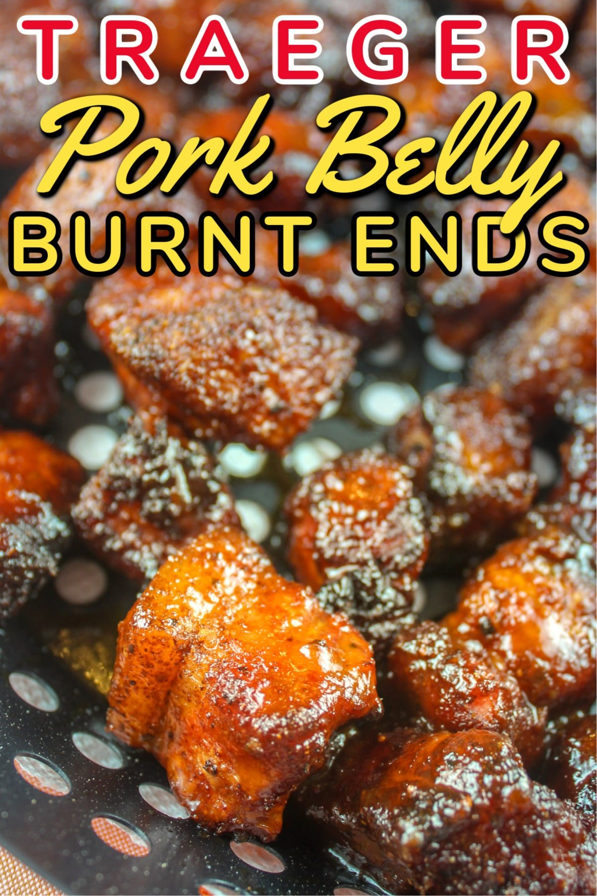 Smoked Pork Belly Burnt Ends are like little pieces of candy MADE OF BACON!!! They're sweet, savory, salty morsels of heaven! They're also a lot easier than you think - I made them on my Traeger Grill and they melt in your mouth! Perfect for your next get-together - or heck - just eat them all yourself!  via @foodhussy