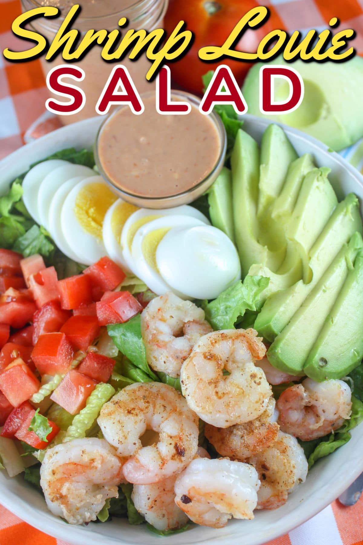 Shrimp Louie is a salad you'll often find in California made with shrimp, lettuce, egg, avocado and tomato. The simple dressing is similar to Thousand Island dressing and super tasty! via @foodhussy