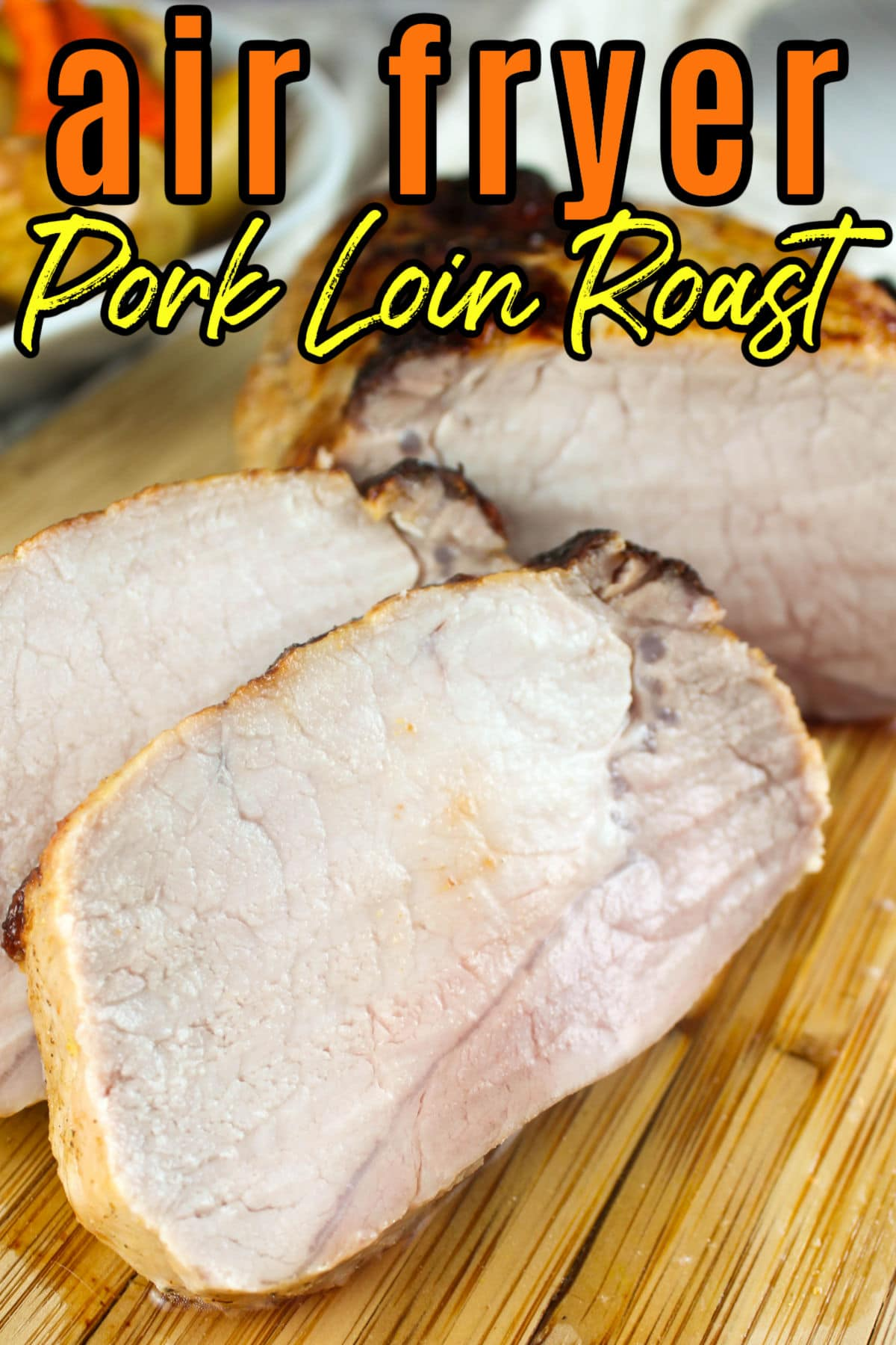 An Air Fryer Pork Roast is delicious and will make some of the juiciest boneless chops you've ever eaten. It's very simple too - just marinate and air fry! Throw in some potatoes and carrots and you've got the whole meal in 40 minutes.  via @foodhussy